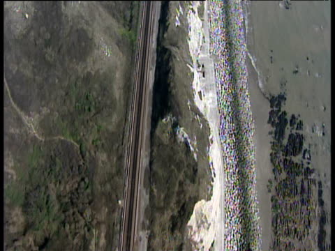 stockvideo's en b-roll-footage met track backwards along kent coast following railway line - kent engeland