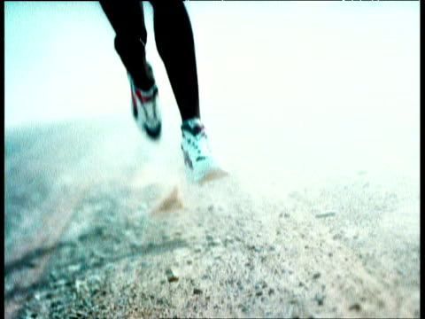 track backwards away from legs running forward towards camera - sports shoe stock videos & royalty-free footage