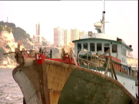 track backwards from boat away from rusty fishing trawler hong kong - imperfection stock videos and b-roll footage
