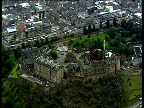 Track backwards from Edinburgh Castle and city during the day.