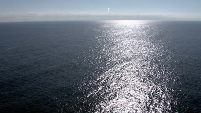 track down over sparkling surface of sea, pacific ocean - horizont stock-videos und b-roll-filmmaterial