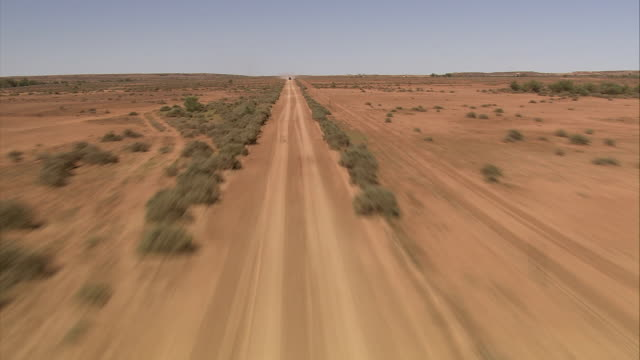 Track forward a dusty road in the outback of Queensland. Available in HD.