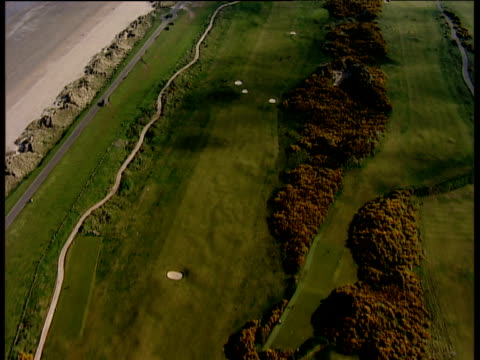 track forward along golf course fairway st andrews links - links golf stock videos & royalty-free footage