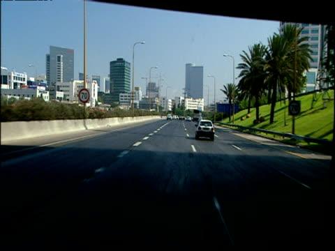 vidéos et rushes de track forward along motorway through urban area jerusalem - jérusalem