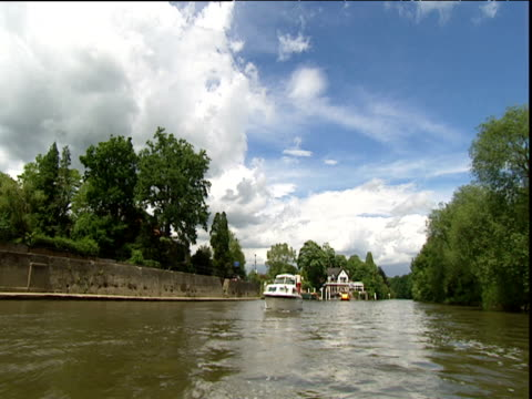 track forward along river thames at henley cruiser passes in other direction - other stock videos & royalty-free footage