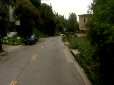 track forward along road through residential area beverly hills - exklusiv stock-videos und b-roll-filmmaterial