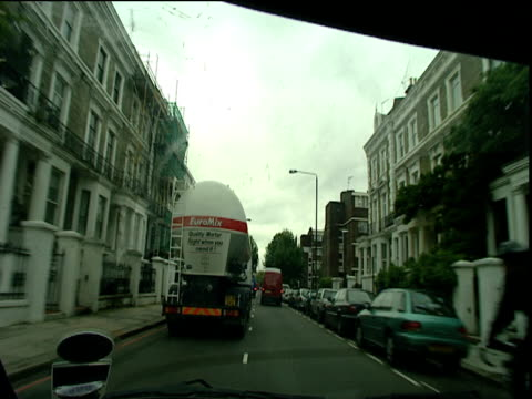 track forward along road through residential area london - 2000s style stock videos & royalty-free footage