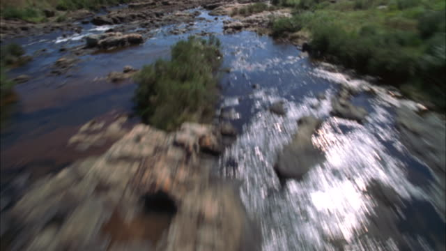 track forward along rocky river and over edge of cliff to waterfalls, blyde river canyon available in hd. - blyde river canyon stock videos and b-roll footage