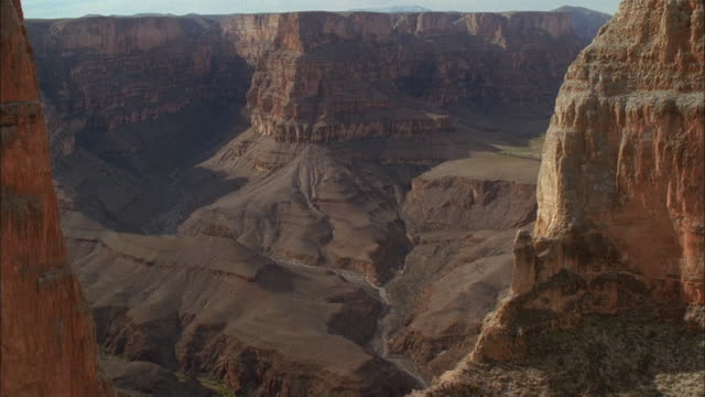 track forward between rock peaks to reveal grand canyon, arizona available in hd. - black canyon stock videos & royalty-free footage