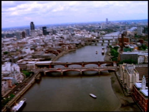 Track forward east along River Thames over Blackfriars Bridge towards Southwark Bridge, Cannon Street Bridge and London Bridge, London; 1990's