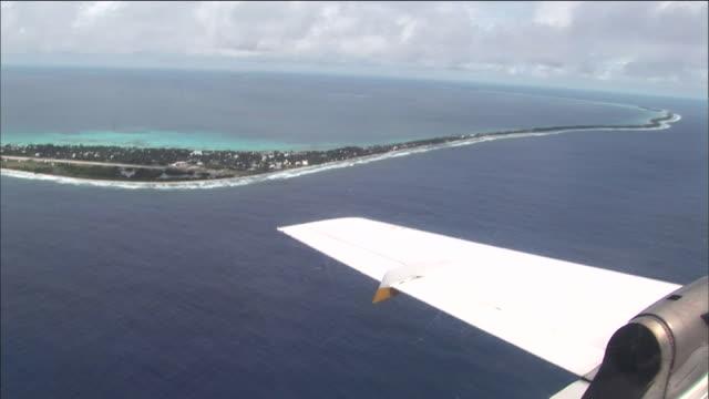 track forward from aeroplane past funafuti, capital of tuvalu - pacific ocean stock videos & royalty-free footage