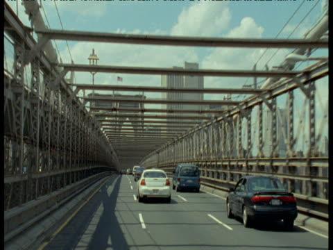 track forward from car crossing brooklyn bridge, new york city - brooklyn bridge stock videos & royalty-free footage