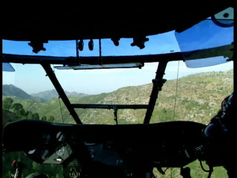 track forward in helicopter flying over green mountains nowshera district pakistan - eskapismus stock-videos und b-roll-filmmaterial