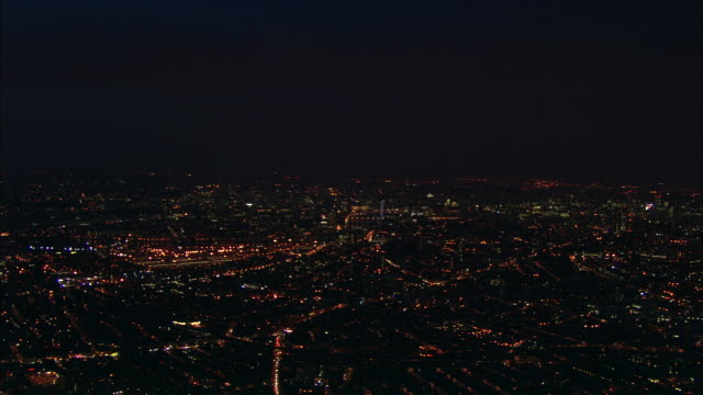 Track forward over bright lights of city London Available in HD.