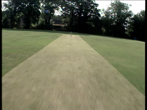 track forward over cricket wicket to village surrounded by fields crawley hampshire - cricket stump stock videos & royalty-free footage