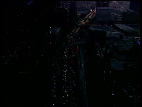 vídeos de stock e filmes b-roll de track forward over downtown los angeles camera follows traffic along motorway between skyscrapers - 1995