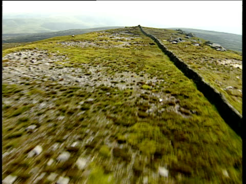 track forward over dry stone wall along ridge of hill pennines - pennines stock videos & royalty-free footage