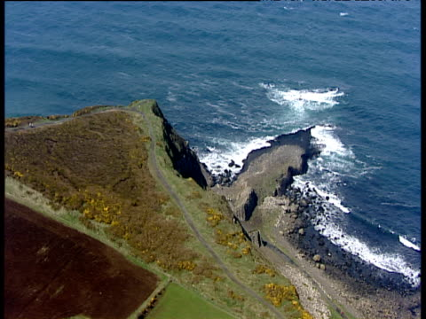 Track forward over edge of cliff to Giant's Causeway headland Northern Ireland