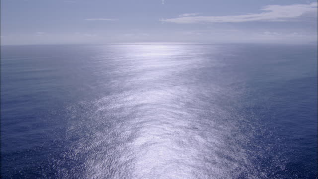 Track forward over empty blue ocean, Galapagos Islands Available in HD.