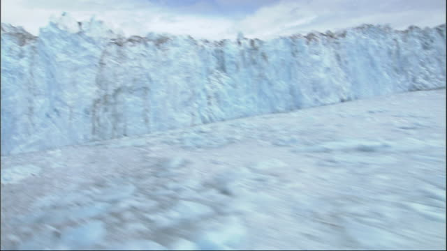 track forward over frozen surface at columbia glacier alaska. available in hd. - columbia glacier stock videos & royalty-free footage