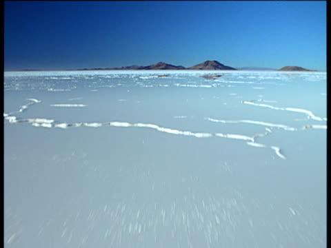 Track forward over Patagonian salt plains Bolivia