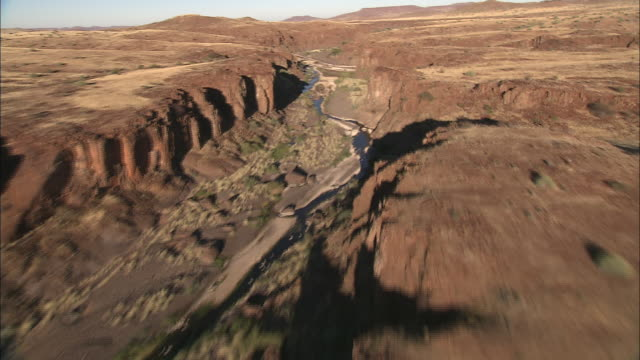 Track forward over river running through a deep canyon near the Kalahari Desert. Available in HD.