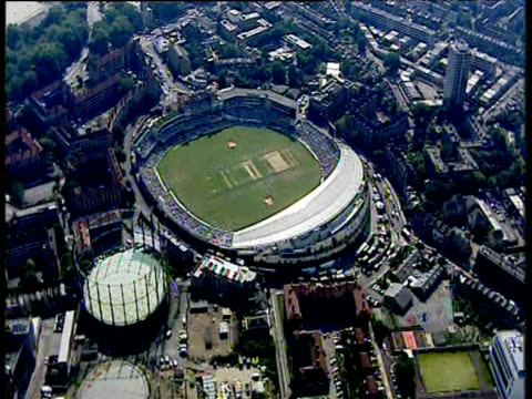 track forward over the oval cricket ground packed with spectators watching match london - cricket stock videos & royalty-free footage