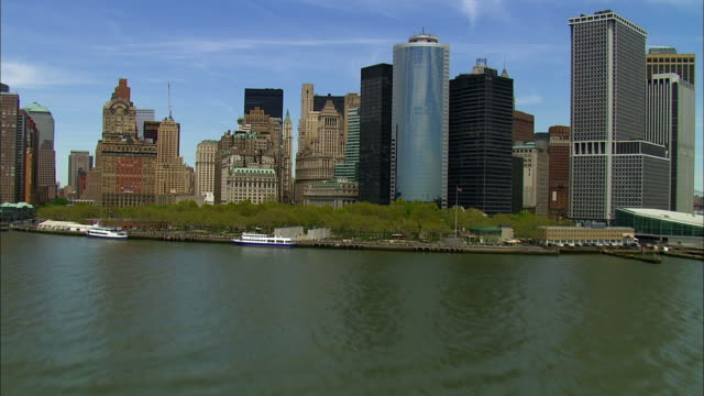 Track forward over water towards Manhattan and over city Available in HD.