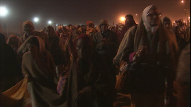 Track forward through crowd of advancing Kumbh Mela pilgrims, Allahabad, Uttar Pradesh, India