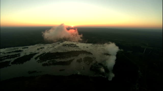 Track forward towards horizon and Victoria Falls, Zimbabwe,_Aerial Shot