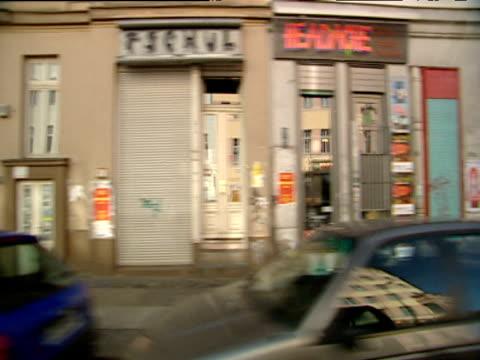 vídeos de stock, filmes e b-roll de track from car driving through suburban streets of east berlin - east berlin