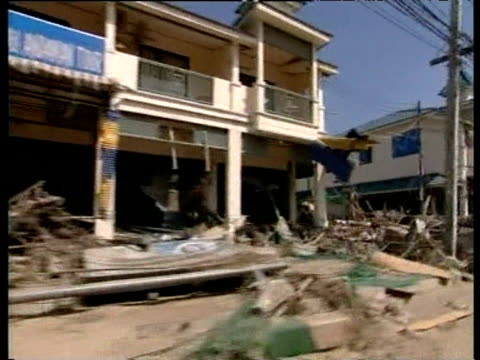 track from car past row of buildings ruined by tsunami khao lak thailand 4 jan 05 - damaged stock videos & royalty-free footage