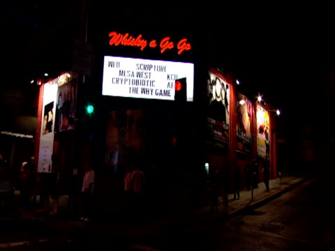 track from car past small crowd outside whiskey a go go sunset strip los angeles - sunset boulevard stock-videos und b-roll-filmmaterial