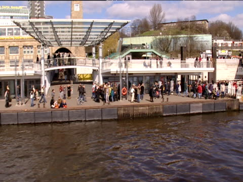 track from deck of boat past ferries paddle steamers and houses hamburg - paddle boat stock videos & royalty-free footage