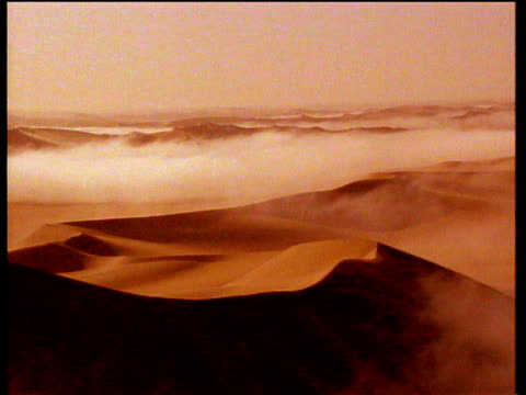 track left across desert landscape with orange sepia effect - sepia stock videos & royalty-free footage
