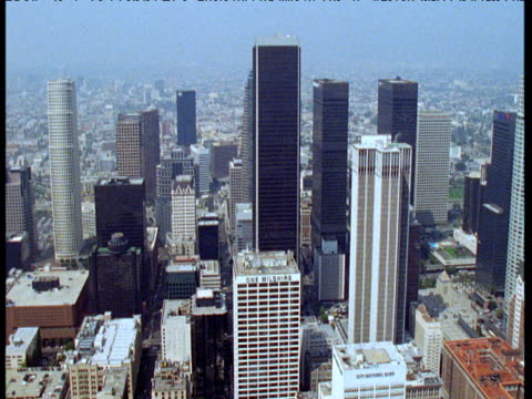 Track left across skyscrapers in central business district, Los Angeles