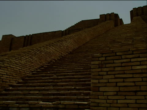 Track left across stairway on ancient ruins of the city of Iraq