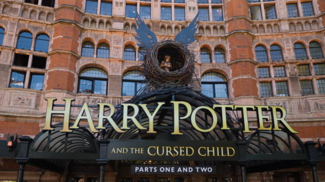 track left across the entrance to harry potter and the cursed child at the palace theatre, london - ウェストエンド点の映像素材/bロール