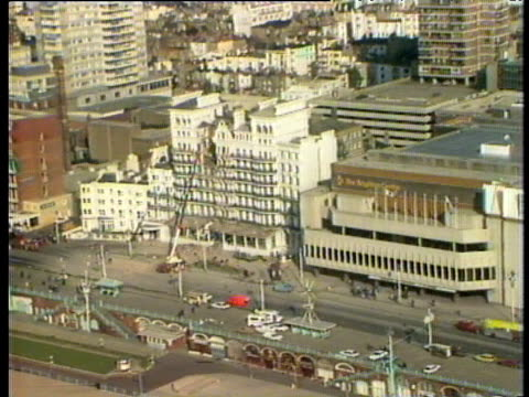 track left along sea front zoom in to bomb damaged hotel with crane in front ira bombing of grand hotel brighton oct 84 - brighton brighton and hove stock-videos und b-roll-filmmaterial