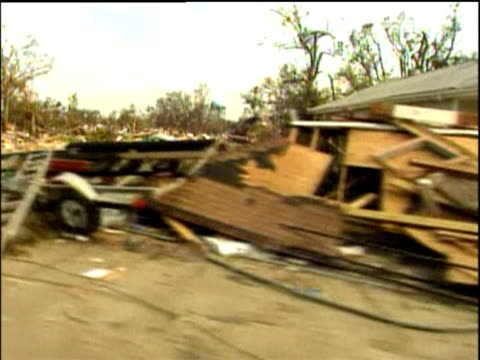 track left along street of flattened houses and wreckage caused by hurricane katrina 31 aug 05 - hurricane katrina stock videos and b-roll footage