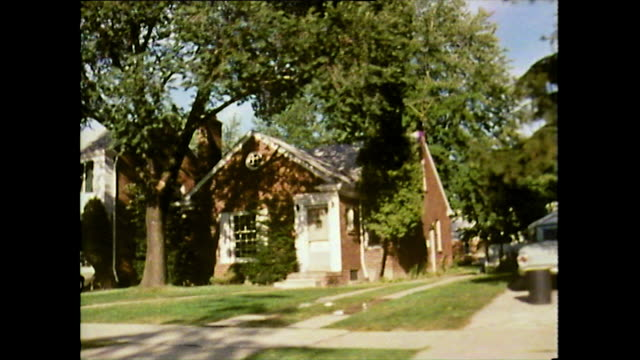track left along suburban street in detroit; 1972 - michigan stock videos & royalty-free footage