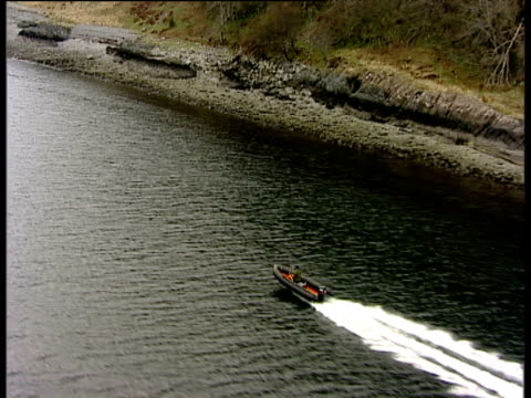 track left alongside fast moving rigid inflatable boat on loch nevis argyllshire - speed boat stock videos & royalty-free footage