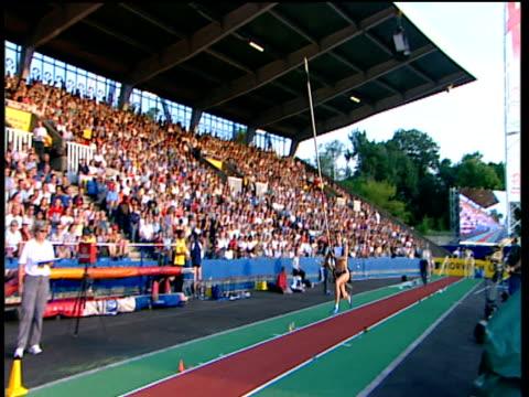 Track left and crane up on Yelena Isinbayeva Women's Pole Vault 2004 Crystal Palace Athletics Grand Prix London