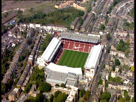 track left around highbury football stadium and surrounding houses - surrounding stock videos & royalty-free footage