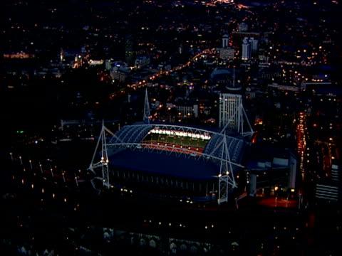 track left around millennium stadium with roof open illuminated at night cardiff - millennium stadium stock videos & royalty-free footage