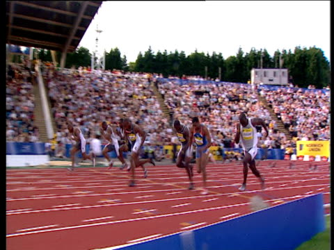 track left as asafa powell winning men's 100m heat 2004 crystal palace athletics grand prix london - the end stock videos & royalty-free footage