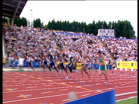 track left as maurice greene win's men's 100m heat 2 2004 crystal palace athletics grand prix london - men's track stock videos and b-roll footage