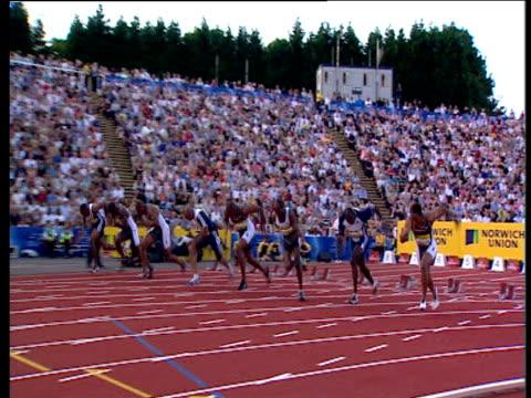 track left following asafa powell winning men's 100m 2004 crystal palace athletics grand prix london - men's track stock videos and b-roll footage