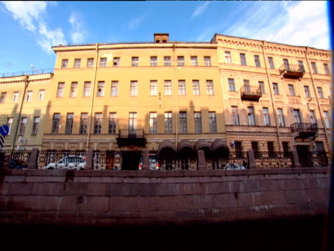 Track left from boat along embankment and buildings St Petersburg