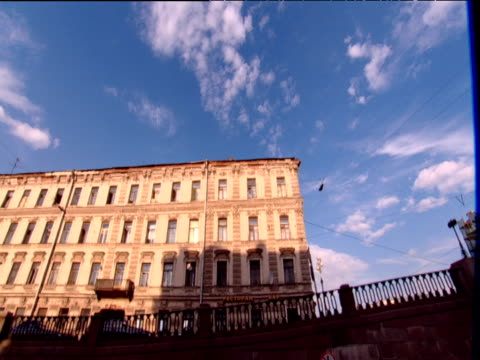 track left from boat along embankment past apartment buildings st petersburg - 階点の映像素材/bロール